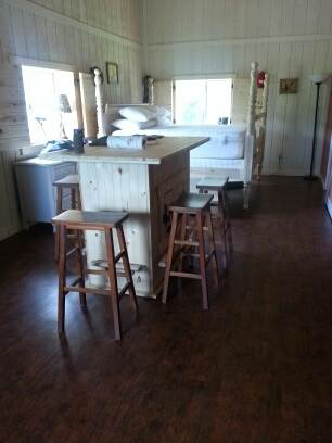 Kitchen Island, with poster bed in background.